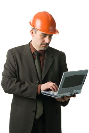 Engineer with a laptop, isolated on white Stock Photo
