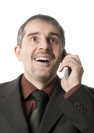A happy businessman talking on the cellular phone photo