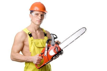 A sexy muscular man with chain-saw, isolated on white photo