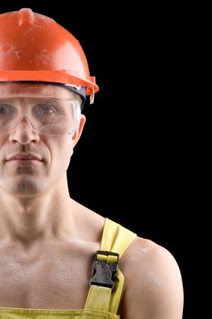 Construction worker, covered with dustr, isolated on black Stock Photo - 772213