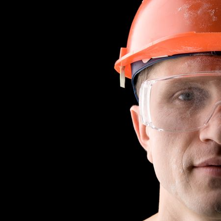 Construction worker covered with dust, isolated on black Stock Photo - 772214