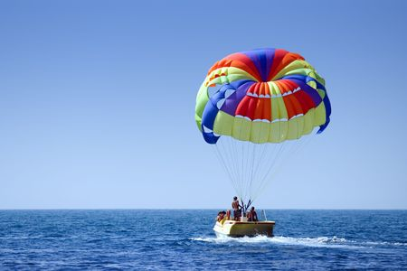 parasailing: A motorboat with parachute, prepared for parasailing