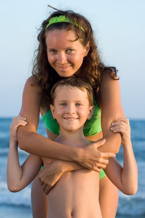 Mother and her son on the beach photo