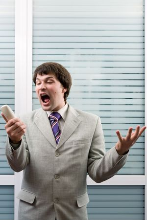 Man shouting on the phone in an office Stock Photo - 826926