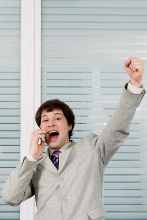 A happy successful businessman talking on the phone