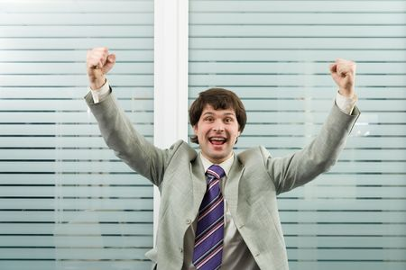 bandwagon: A very happy businessman in the office Stock Photo