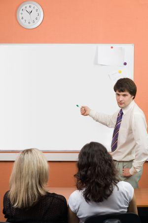 A man pointing on blackboard on seminar\meeting