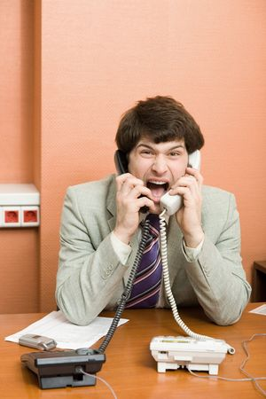 A stressed businessman shouting on the phones Stock Photo - 846135