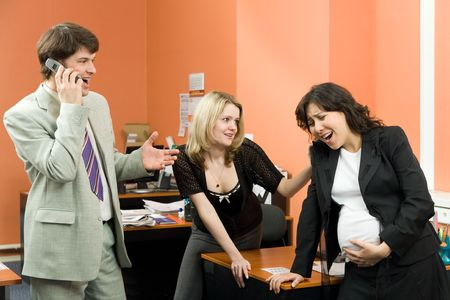 A pregnant woman having some conractions in the office photo