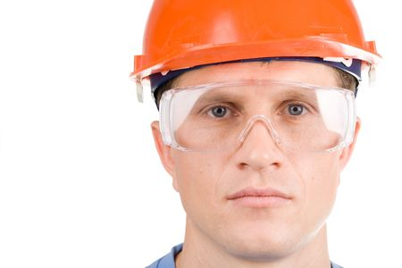 A headshot of a builder in hardhat Stock Photo
