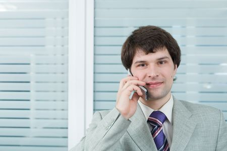 Young businessman with cellular in the office Stock Photo - 861679