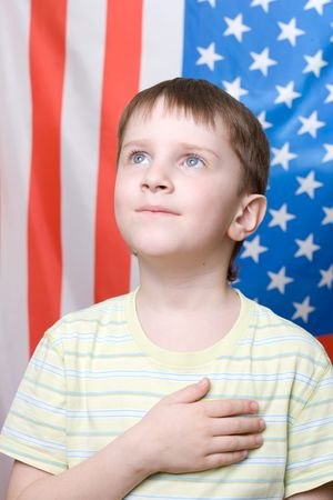 anthem: A boy listening national anthem on 4th of July Stock Photo