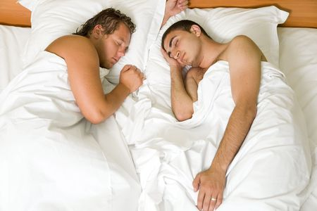A homoual couple sleeping in the bed photo