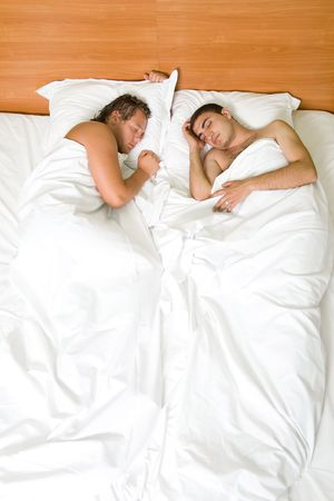 gay men: A homoual couple sleeping in the bed