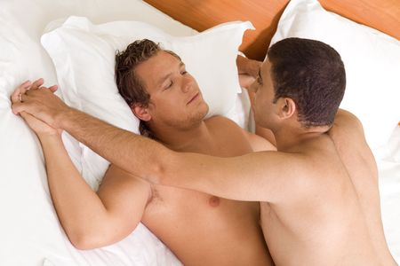 A homoual couple having  on the bed photo
