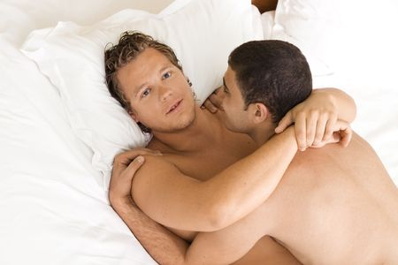 A homoual couple hugging in the bed Stock Photo