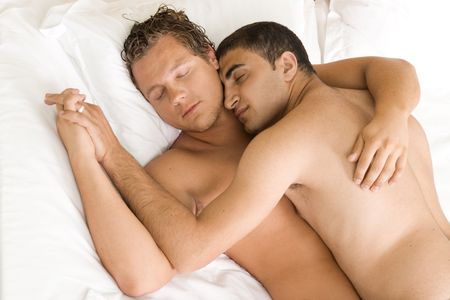 A homoual couple sleeping in the bed