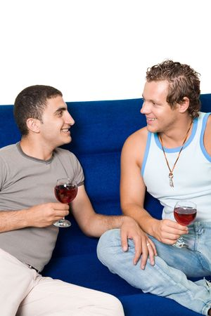 Two homosexual men drinking wine on the sofa Stock Photo - 1134156