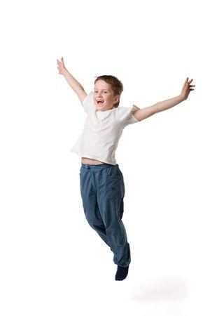 joyfull: A joyfull kid jumping on white backgound