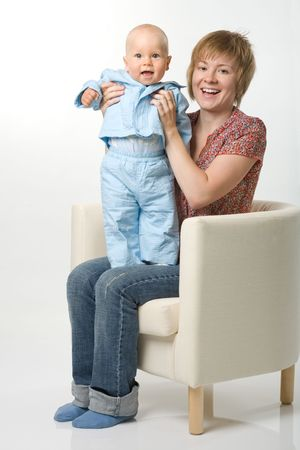 Mother and her baby sitting on chair Stock Photo - 1229549
