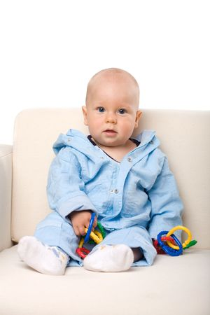 A baby sitting on the sofa, isolated Stock Photo - 1229553