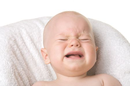 colic: A portrait of a crying baby, isolated Stock Photo