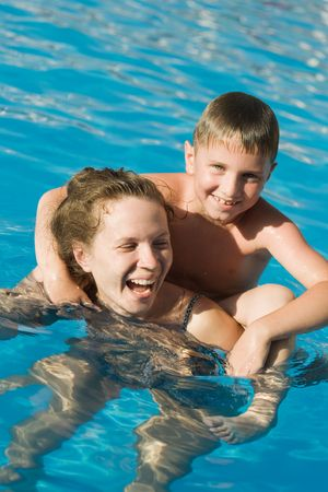 Mother and her son in the swimming pool photo