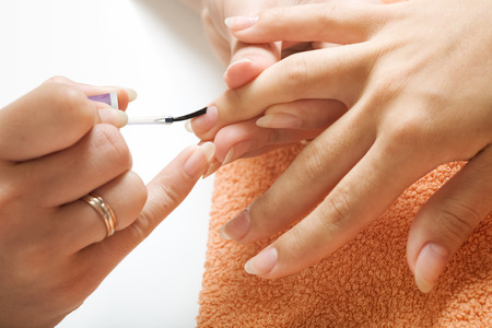 Nail polishing during manicure in the salon Stock Photo - 1415571