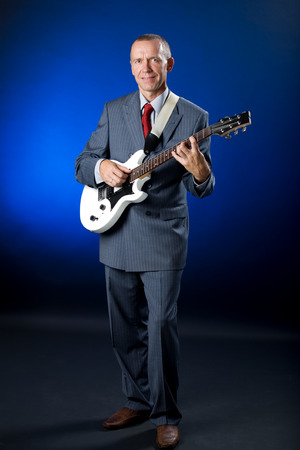 A senior man playing the electric guitar Stock Photo - 1630488