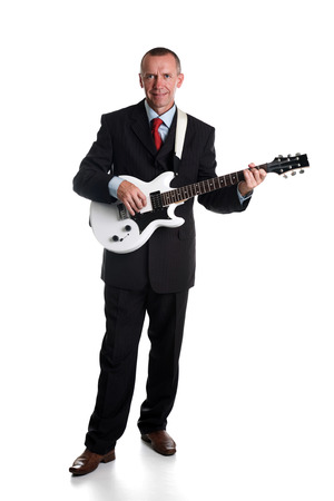 A senior man playing the electric guitar photo