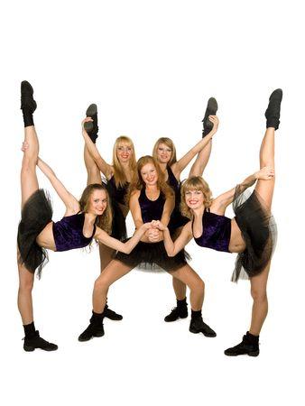 porrista: Un equipo de los cheerleaders de cinco personas, aislado