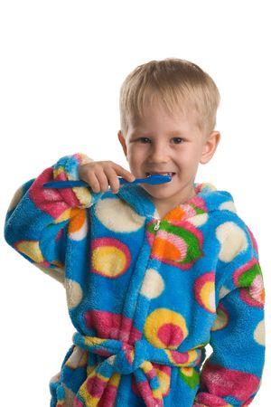 A three years old boy brushing teeth, on white Stock Photo - 3112042