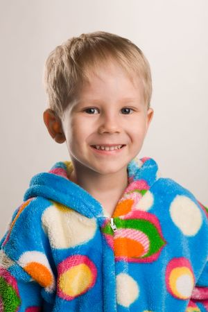 3 year old boy: A photo of a 3 year old boy in bathrobe, smiling Stock Photo
