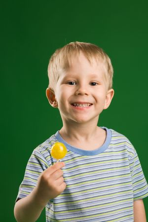 A photo of happy  boy with  lollipop photo