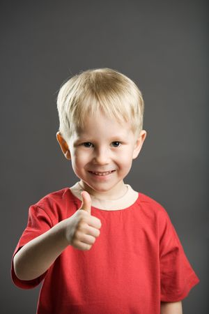 A photo of a boy with thumb up! photo