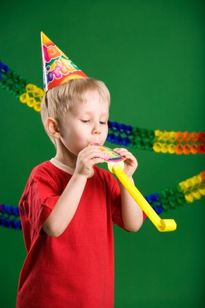 A photo of a boy on birthday party photo