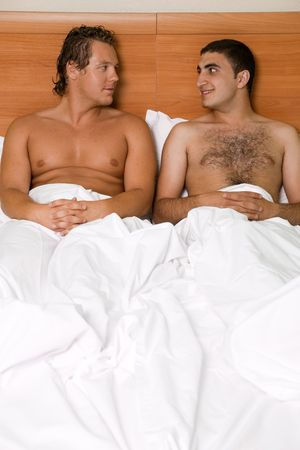 gay couple: A homoual couple in the bed room