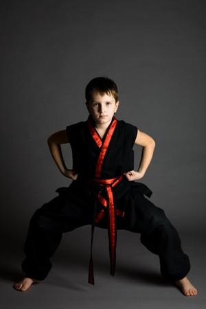 Boy in a black kimono on a grey background Stock Photo - 4127428
