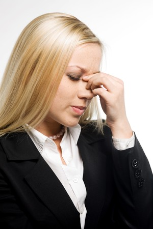 Business woman suffers from a headache on a white background photo