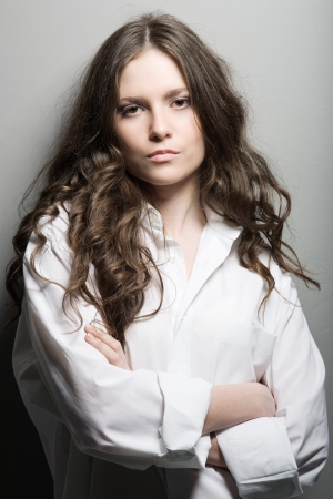 Portrait of the young woman in a man's shirt