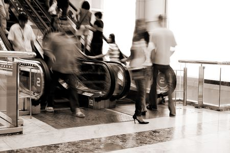 action blur: Abstract of people moving on escalator in the shopping mall(signs on escalator - bowling, karaoke)