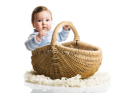 A of baby in the basket, isolated photo