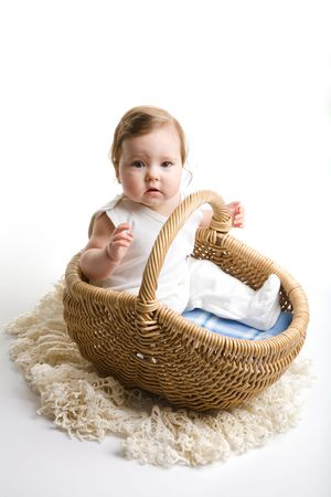 A of baby inside the basket, isolated photo