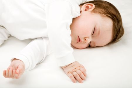 of a baby, sleeping, isolated on white