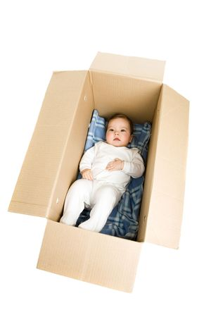 baby open present: A of baby lying in the box