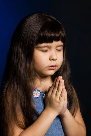 worshipper: A of a girl, praying, isolated