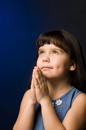 A of a girl, praying, isolated Stock Photo