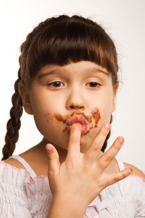 A of a girl, who just ate some chocolate Stock Photo - 5226716