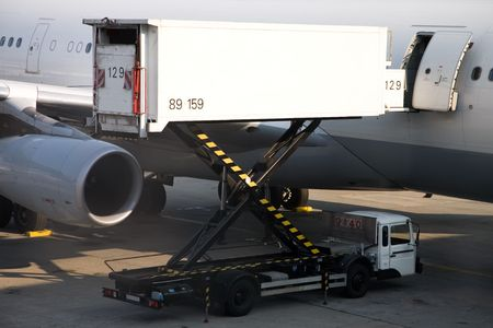 Photo of a cargo truck, loading in the plane photo