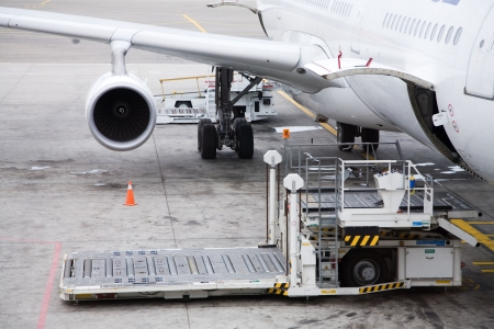 loading cargo: of a cargo unloading process in the airport Stock Photo